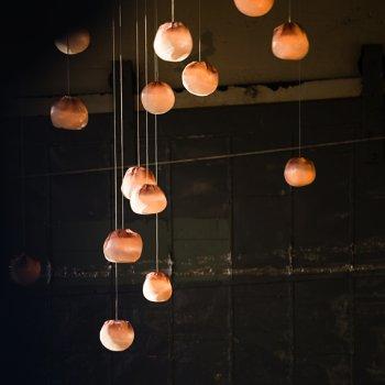 Shown in Copper finish, White glass, in use