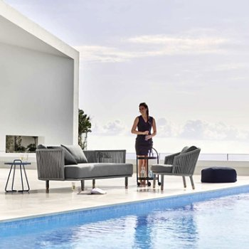Pictured with the Moments Lounge Chair, the On The Move Side Table, and the Divine Footstool (sold separately)
