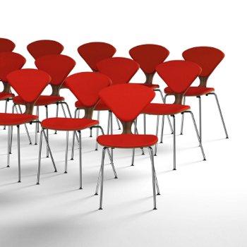 Shown in Stella Orange Seat, Chrome Base option, collection
