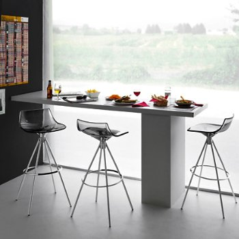 Shown in Transparent Smoke Grey, Chromed finish, Counterstool, in use
