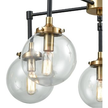 Shown in Matte Black and Antique Gold finish with Clear Blown Shade, lit