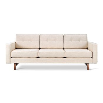 Shown in Huron Ivory with Walnut legs finish