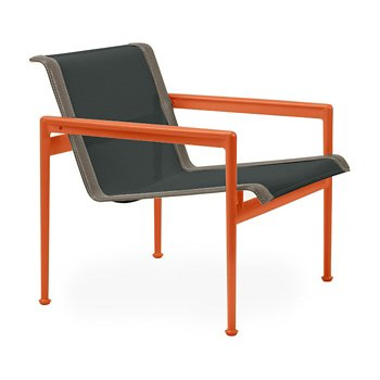 Shown in Onyx Fabric, Orange Frame, Sand Trim