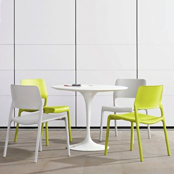 Spark Stacking Side Chair with Saarinen Round Dining Table