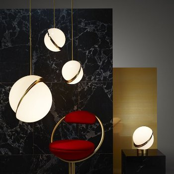 Shown in Brushed Brass finish, lit, in use