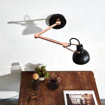 Shown in Matte Black/Shiny Copper finish, lit, in use