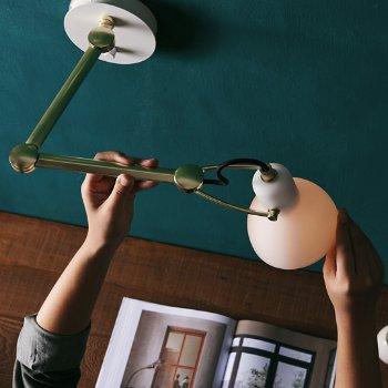 Shown in Opal/Matte Brass finish, lit, in use