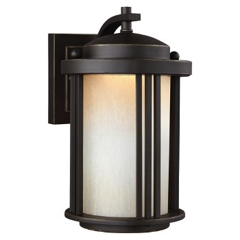 Shown in Antique Bronze finish with Creme Parchment Glass, Small size, lit