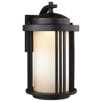 Shown in Antique Bronze finish with Creme Parchment Glass, Medium size, lit