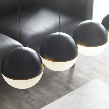 Shown in Matte Black/Aged Brass shade with Aged Brass finish, in use
