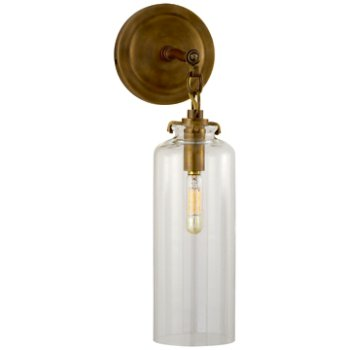 Shown in Hand-Rubbed Antique Brass finish with Clear shade