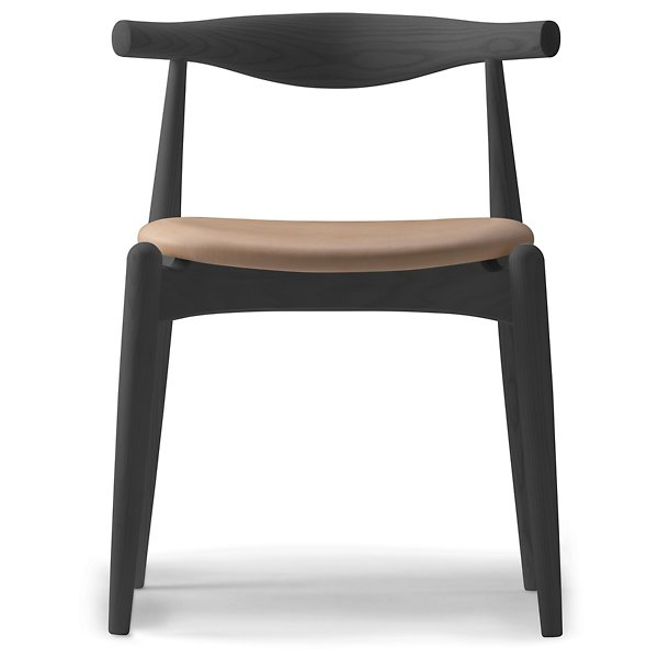 wood chair with the back in the shape of an elbow