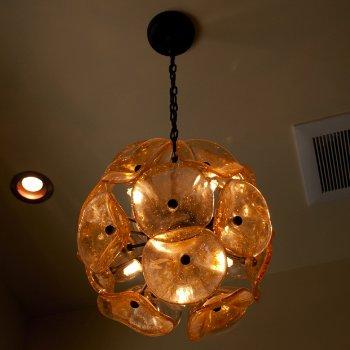 Shown in Amber Murano glass, Bronze Finish, lit